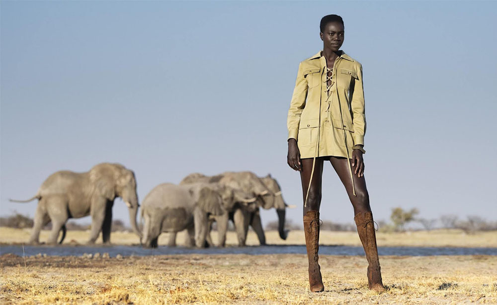 South Sudanese refugee and rising model Nyamuoch Girwath works with photographer David Yarrow on ''Call Of The Wild'', a fashion story shot on location in Botswana for Harper's Bazaar US' October 2019 issue.
